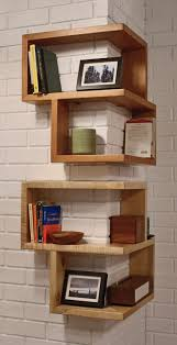 home organization corner white wood book shelf under stair