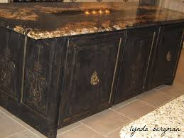 black distressed kitchen island lynda bergman decorative artisan painted bird nest artwork