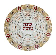 rosh hashanah seder plate with pomegranates diamonds and hebrew text