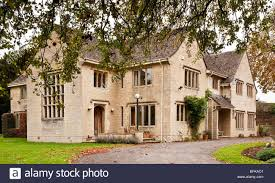 exterior of a posh grand expensive english country house manor or