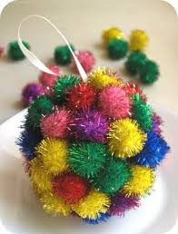 jingly pom pom ornaments with a preschooler
