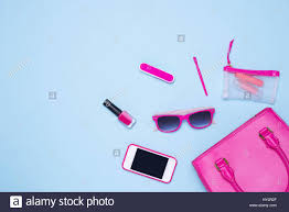 Pink Flat Color Flat Lay Of Female Fashion Accessories And White Handbag On Blue