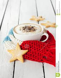 winter cappuccino coffee in white cup with christmas cookies