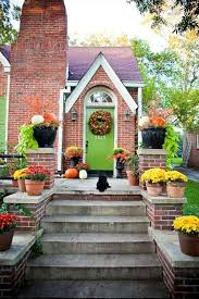 green door with red brick fall porch love the lime green color