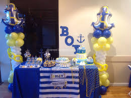 baby shower anchor theme cake and dessert table with 2 beautiful anchor theme balloon