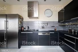 modern kitchen black cabinets interior of modern kitchen with black cabinets stock photo image now