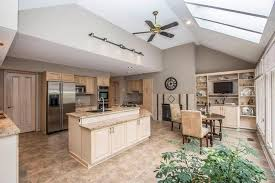 traditional kitchen with travertine tile floors skylight in