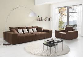 accent wall paint colors for living room with dark brown couch and