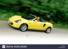 yellow toyota car toyota mr2 convertible model year 2000 yellow driving