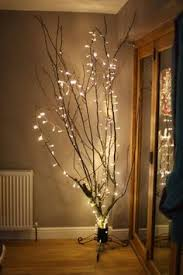 tree branches and white lights in a bedroom search