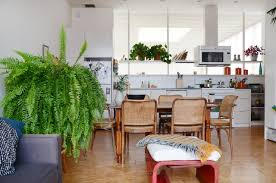 two lofts with the same plain rental kitchen prove the power of