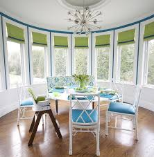 white and blue dining room with nickel sputnik chandelier