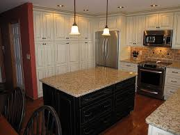 creamy cabinets yellowgold granite and pink beige travertine