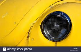 yellow volkswagen beetle royalty free headlight volkswagen beetle stock photo royalty free image