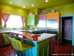 vibrant mexican kitchen color with round island and yellow paint
