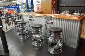 themed bar stools i d to this in my garage bar stools made from rims