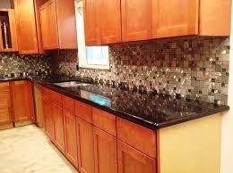 Kitchen Backsplash For Black Granite Countertops - black galaxy granite countertop kitchen traditional with