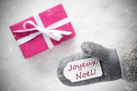 pink gift glove joyeux noel means merry snowflakes