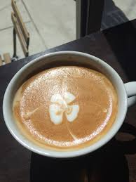 coffee with four leaf clover pattern the proxy project