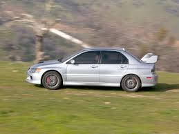 mitsubishi lancer evolution 9 2006 mitsubishi lancer evolution ix side speed 1024x768