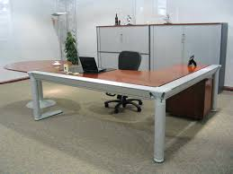 office design wood top desk and white chair by haworth furniture