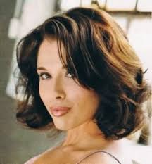modern style with medium length wavy haircut and brown hair color