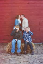 funny country style family portrait session red barn and hay
