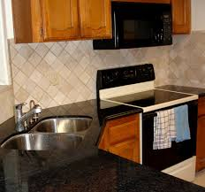 kitchen brown wooden kitchen cabinet with granite backsplash and