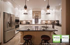 dark granite counters and white lacquered u0027shaker u0027 cabinets make