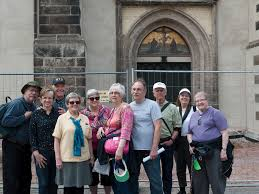 martin luther 95 thesis st paul s reformation tour traveling in the path of martin luther the castle church in wittenberg the arched door behind us is where university announcements were