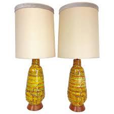 amazing pair of thick lava glaze orange ceramic lamps with walnut
