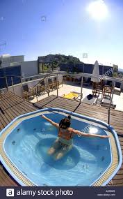 woman in jacuzzi roof rooftop hotel plaka athens greece greek
