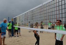 news detail beach volleyball enthusiasm and strong winds keep