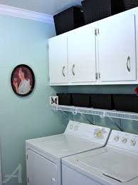 interior laundry room design with blue interior color and white