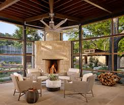 limestone fireplace sunroom contemporary with beamed ceiling