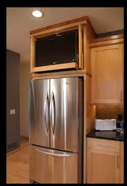 space between top of refrigerator and cabinet kitchen cabinet above refrigerator space tv kitchen 404