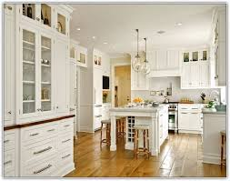 space above kitchen cabinets should you decorate above kitchen cabinets how to decorate top of