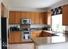 kitchen backsplash with light brown cabinets how to wallpaper a backsplash the homes i made