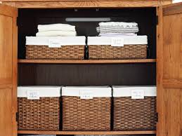 organizing a linen closet linens storage baskets and organizing