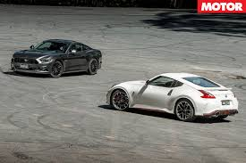 nissan 370z nismo wrapped 2017 ford mustang vs 2017 nissan 370z nismo review motor