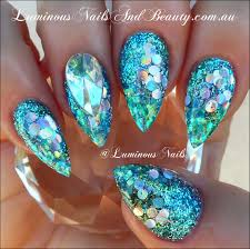 luminous nails glittery blue acrylic nails nails u0026 make up