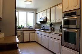 white kitchen cabinets wood trim the best way to paint kitchen cabinets no sanding the