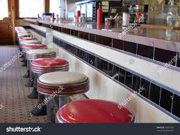 oldfashioned diner tile floor art deco stock photo 35614330 an old fashioned diner with a tile floor and art deco style bar stools
