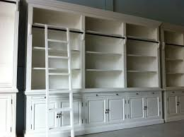 shabby chic white bookshelf with glass doors and drawers front of