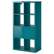 narrow dark brown teak wood bookshelf as room divider in stair