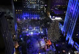 christmas comes to nyc with the annual rockefeller center tree