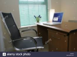 apple laptop computer in home office environment stock photo