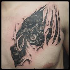 panther ripping through skin by rodriguez tattoonow