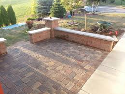 Backyard Brick Patio Design With Grill Station Seating Wall And by Friedges Inc Residential Division Friedges Landscaping Inc