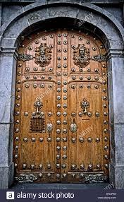 Wooden Door Vintage Wooden Doors With Fanciful Silver Decorations And Door